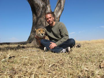 I don't know what's happening here, but it's Paul Walker with a cheetah so why not?